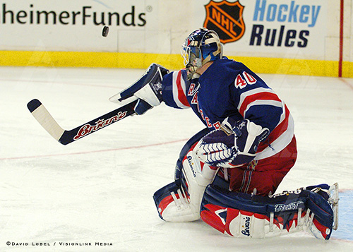 NEW YORK, Feb. 21, 2004 — New York Rangers goaltender Jussi Markkanen bats away a shot with his stick, Saturday afternoon at Madison Square Garden during a 7-3 loss to the New Jersey Devils.