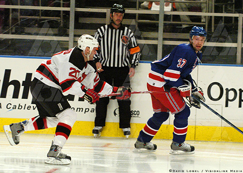 NEW YORK, Feb. 21, 2004 — New Jersey Devils left winger Jay Pandolfo points his stick at New York Rangers winger Jan Hlavac during the Devils' 7-3 win, Saturday afternoon at Madison Square Garden.