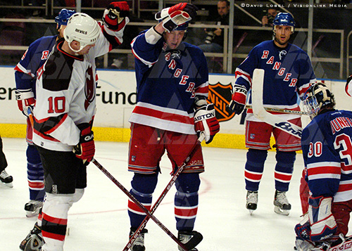 NEW YORK, Feb. 21, 2004 — New Jersey Devils forward Erik Rasmussen and New York Rangers winger Martin Rucinsky wait for play to resume during the Devils' 7-3 win, Saturday at Madison Square Garden.