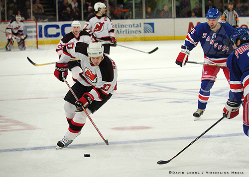 NEW YORK, Feb. 21, 2004 — New Jersey Devils forward Erik Rasmussen moves the puck past center ice during a 7-3 win over the New York Rangers, Saturday afternoon at Madison Square Garden.