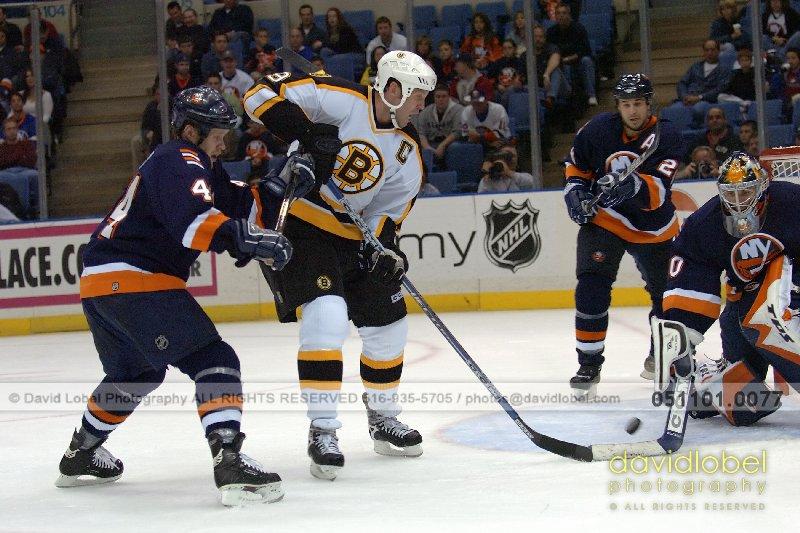 UNIONDALE, NY - November 1, 2005: Islanders Janne Niinimaa (#44), Bruin's Joe Thornton (#19), Islanders Brad Lukowich (#25) and Islander Goalie Garth SNow (#30).