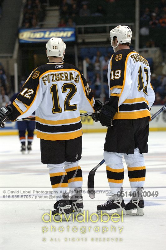 UNIONDALE, NY - November 1, 2005: Boston Bruin's Tom Fitzgerald (#12, left) and Joe Thornton (#19, right)