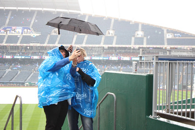 Fans endure heavy rain on opening day to get a selfie at Kafuman Stadium.