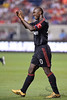 30 May2010:  AC Milan midfielder Clarence Seedorf (10) applauds the fans during the friendly match between the Chicago Fire and AC Milan at Toyota Park in Bridgeview, Illinois.  AC Milan defeated the Fire 1-0.<br /> Mandatory Credit: John Rowland / Southcreek Global