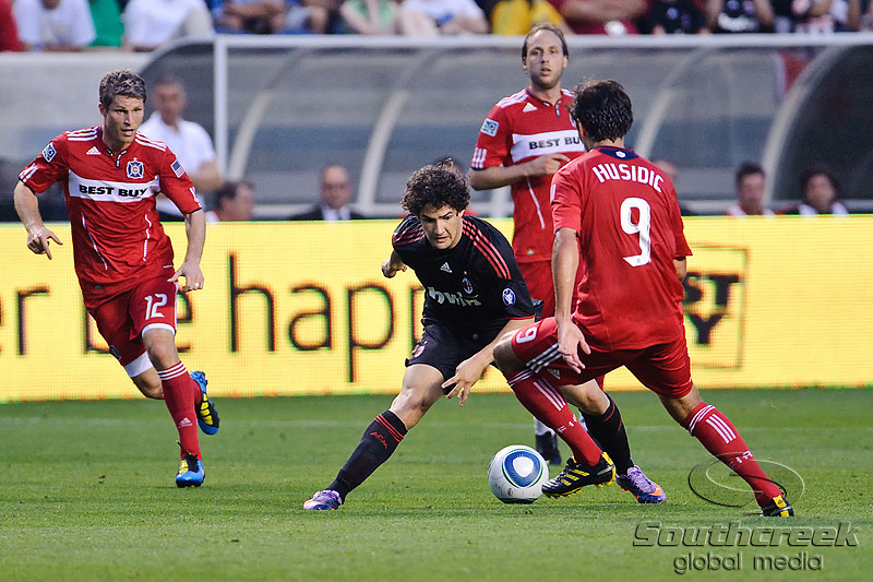 30 May2010:  AC Milan midfielder Alexandre Pato (7) makes a move on Chicago Fire midfielder Baggio Husidic  (9) during the friendly match between the Chicago Fire and AC Milan at Toyota Park in Bridgeview, Illinois.  AC Milan defeated the Fire 1-0.<br /> Mandatory Credit: John Rowland / Southcreek Global