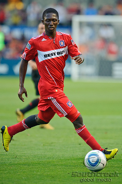30 May2010:  Chicago Fire midfielder Patrick Nyarko (14) dribbles the ball during the friendly match between the Chicago Fire and AC Milan at Toyota Park in Bridgeview, Illinois.  AC Milan defeated the Fire 1-0.<br /> Mandatory Credit: John Rowland / Southcreek Global