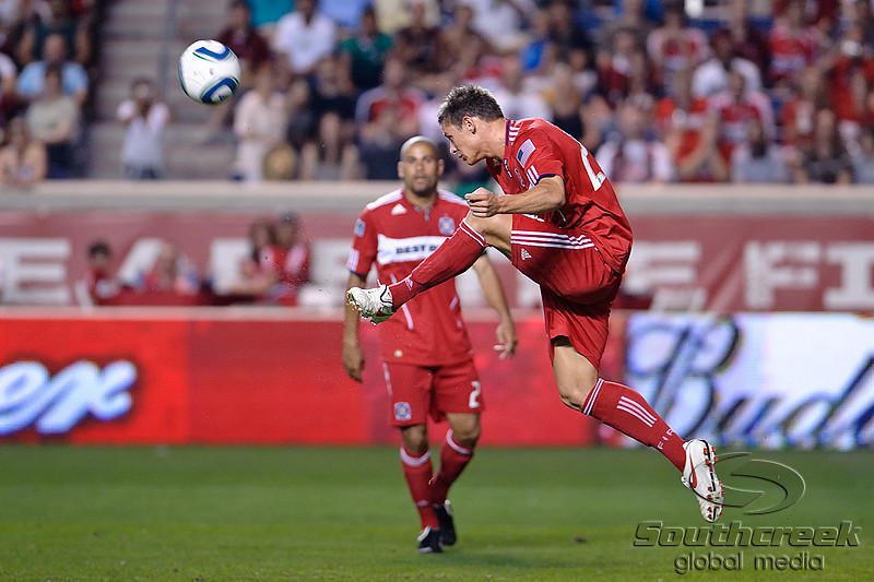 30 May2010:  Chicago Fire defender Krzysztof Krol (23) clears the ball out of danger during the friendly match between the Chicago Fire and AC Milan at Toyota Park in Bridgeview, Illinois.  AC Milan defeated the Fire 1-0.<br /> Mandatory Credit: John Rowland / Southcreek Global