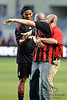 30 May2010:  An AC Milan fan is pulled away by security after running onto the field to kiss the shoes of Ronaldinho (80) during the friendly match between the Chicago Fire and AC Milan at Toyota Park in Bridgeview, Illinois.  AC Milan defeated the Fire 1-0.<br /> Mandatory Credit: John Rowland / Southcreek Global