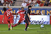 30 May2010:  AC Milan midfielder Alexandre Pato (7) splits two Chicago Fire defenders during the friendly match between the Chicago Fire and AC Milan at Toyota Park in Bridgeview, Illinois.  AC Milan defeated the Fire 1-0.<br /> Mandatory Credit: John Rowland / Southcreek Global