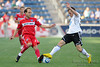 22 May2010:  Chicago Fire midfielder Justin Mapp (21) tries to avoid the tackle of a Legia Warsaw defender during the consolation match of the Chicago Sister Cities Cup between the Chicago Fire and Legia Warsaw at Toyota Park in Bridgeview, Illinois.  Legia Warsaw defeated the Fire 3-0.<br /> Mandatory Credit: John Rowland / Southcreek Global