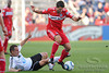 22 May2010:  Chicago Fire midfielder Peter Lowry (8) evades a tackle by a Legia defender during the consolation match of the Chicago Sister Cities Cup between the Chicago Fire and Legia Warsaw at Toyota Park in Bridgeview, Illinois.  Legia Warsaw defeated the Fire 3-0.<br /> Mandatory Credit: John Rowland / Southcreek Global