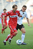 22 May2010:  Chicago Fire midfielder Justin Mapp (21) dribbles past a Legia defender during the consolation match of the Chicago Sister Cities Cup between the Chicago Fire and Legia Warsaw at Toyota Park in Bridgeview, Illinois.  Legia Warsaw defeated the Fire 3-0.<br /> Mandatory Credit: John Rowland / Southcreek Global
