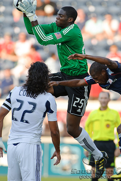 17 July10:  Chicago Fire goalkeeper Sean Johnson (25) catches a crossing attempt in traffic during the Group B SuperLiga match between the Chicago Fire and the New England Revolution at Toyota Park in Bridgeview, Illinois. The Revolution defeated the Fire 1-0.<br /> Mandatory Credit: John Rowland / Southcreek Global