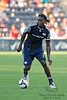 17 July10:  New England Revolution midfielder Shalrie Joseph (21) dribbles the ball upfield during the Group B SuperLiga match between the Chicago Fire and the New England Revolution at Toyota Park in Bridgeview, Illinois. The Revolution defeated the Fire 1-0.<br /> Mandatory Credit: John Rowland / Southcreek Global