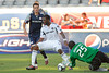 17 July10:  Chicago Fire defensive back Kwame Watson-Siriboe shields a New England attacker, allowing goalkeeper Sean Johnson (25) to grab a loose ball during the Group B Superliga match between the Chicago Fire and the New England Revolution at Toyota Park in Bridgeview, Illinois. The Revolution defeated the Fire 1-0.<br /> Mandatory Credit: John Rowland / Southcreek Global