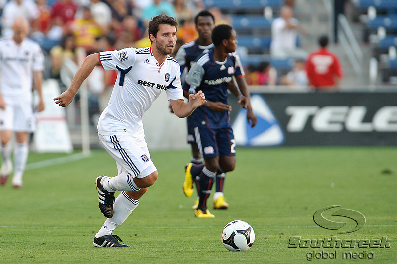 17 July10:  Chicago Fire forward Peter Lowry (8) dribbles the ball upfield during the Group B Superliga match between the Chicago Fire and the New England Revolution at Toyota Park in Bridgeview, Illinois. The Revolution defeated the Fire 1-0.<br /> Mandatory Credit: John Rowland / Southcreek Global