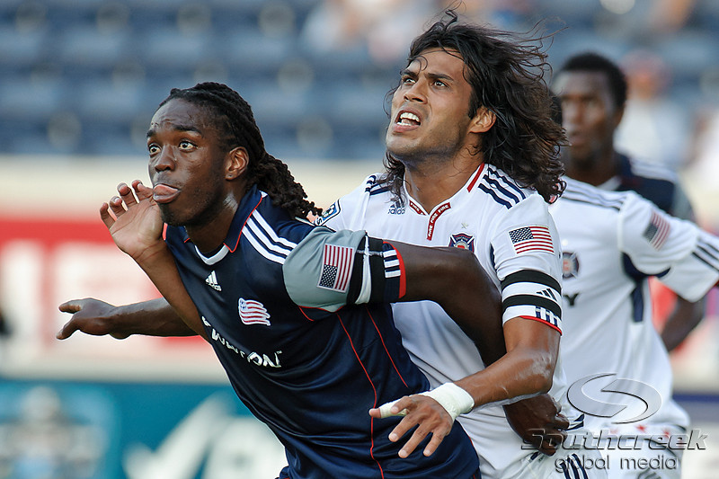17 July10:  Chicago Fire Defender Wilman Conde (22) and New England Revolution midfielder Shalrie Joseph (21) battle for position on a corner kick during the Group B SuperLiga match between the Chicago Fire and the New England Revolution at Toyota Park in Bridgeview, Illinois. The Revolution defeated the Fire 1-0.<br /> Mandatory Credit: John Rowland / Southcreek Global