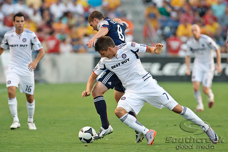 17 July10:  Chicago Fire forward Stefan Dimitrov (7) has the ball taken from him by New England Revolution midfielder Chris Tierney (8) during the Group B Superliga match between the Chicago Fire and the New England Revolution at Toyota Park in Bridgeview, Illinois. The Revolution defeated the Fire 1-0.<br /> Mandatory Credit: John Rowland / Southcreek Global