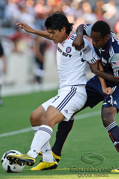 17 July10:  Chicago Fire midfielder Deris Umanzor (13) shields the ball from New England Revolution midfielder Joseph Niouky (23) during the Group B SuperLiga match between the Chicago Fire and the New England Revolution at Toyota Park in Bridgeview, Illinois. The Revolution defeated the Fire 1-0.<br /> Mandatory Credit: John Rowland / Southcreek Global