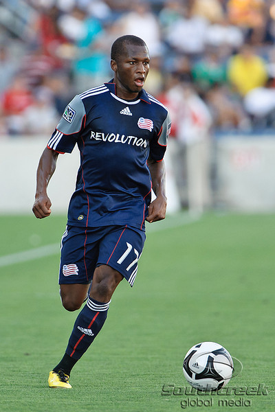17 July10:  New England Revolution midfielder Sainey Nyassi (17) dribbles the ball upfield during the Group B SuperLiga match between the Chicago Fire and the New England Revolution at Toyota Park in Bridgeview, Illinois. The Revolution defeated the Fire 1-0.<br /> Mandatory Credit: John Rowland / Southcreek Global