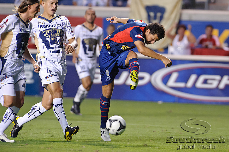 17 July10:  Monarcas Morelia forward Miguel Sabah (9) fires a shot during the Group B SuperLiga match between Monarcas Morelia and Pumas UNAM at Toyota Park in Bridgeview, Illinois. The teams played to a 2-2 draw.<br /> Mandatory Credit: John Rowland / Southcreek Global