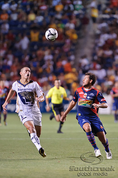 17 July10:  Pumas defender Dario Veron (4) and Morelia forard Miguel Sabah (9) fight for a loose ball during the Group B SuperLiga match between Monarcas Morelia and Pumas UNAM at Toyota Park in Bridgeview, Illinois. The teams played to a 2-2 draw.<br /> Mandatory Credit: John Rowland / Southcreek Global