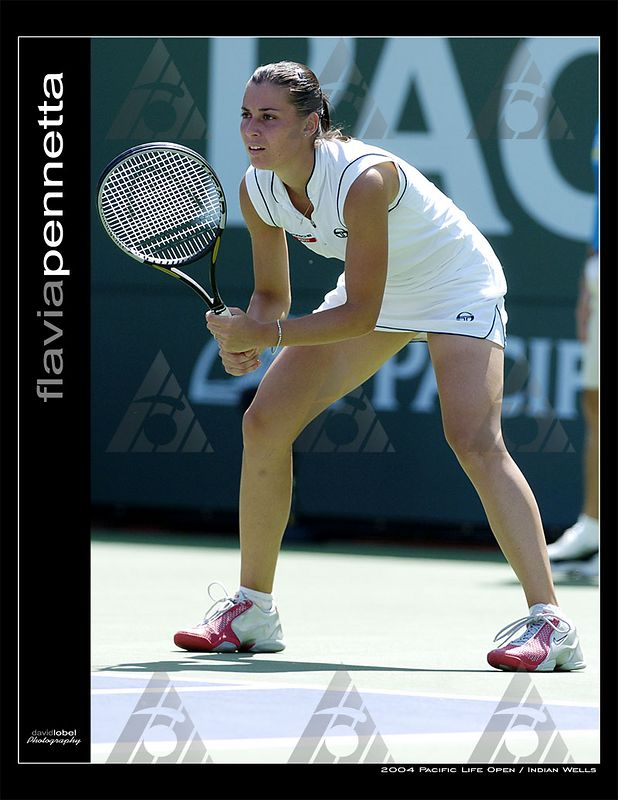 INDIAN WELLS, CA - MAR 13, 2004: Russia's 16th seed Maria Sharapova squeaked out a second round win over Flavia Pennetta (pictured) from Italy, 6-3, 4-6, 6-3 at the Pacific Life Open at Indian Wells.