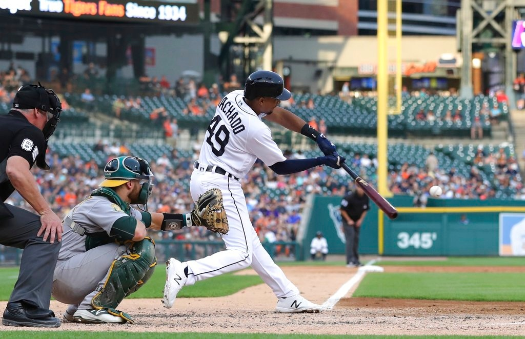 . Detroit Tigers\' Dixon Machado connects for a two-run triple during the third inning against the Oakland Athletics in a baseball game Tuesday, June 26, 2018, in Detroit. (AP Photo/Carlos Osorio)