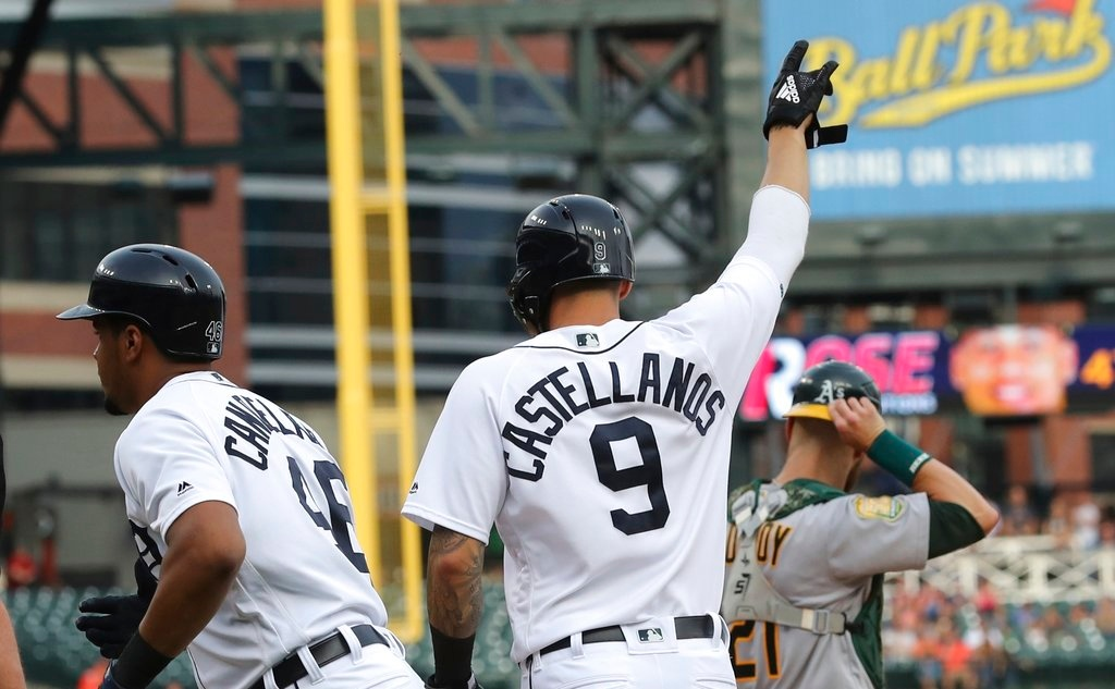 . Detroit Tigers\' Nicholas Castellanos (9) looks towards second base after scoring on Niko Goodrum\'s double during the first inning of a baseball game against the Oakland Athletics, Tuesday, June 26, 2018, in Detroit. (AP Photo/Carlos Osorio)