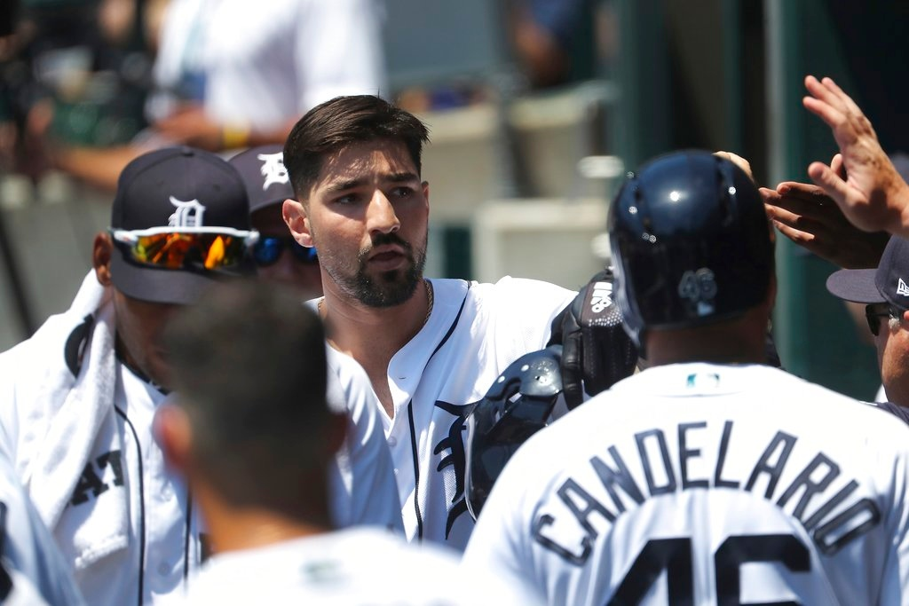 . Detroit Tigers\' Nicholas Castellanos is greeted in the dugout after his two-run home run during the first inning of a baseball game against the Oakland Athletics, Thursday, June 28, 2018, in Detroit. (AP Photo/Carlos Osorio)