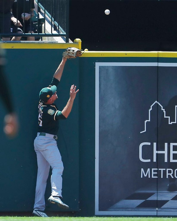 . Oakland Athletics right fielder Stephen Piscotty is unable to catch the two-run home run by Detroit Tigers\' Nicholas Castellanos during the first inning of a baseball game, Thursday, June 28, 2018, in Detroit. (AP Photo/Carlos Osorio)