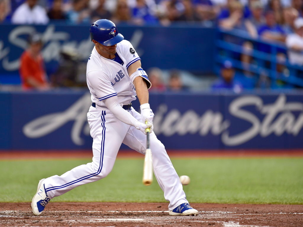. Toronto Blue Jays\' Randal Grichuk hits an RBI single against the Detroit Tigers during the fourth inning of a baseball game Friday, June 29, 2018, in Toronto. (Frank Gunn/The Canadian Press via AP)