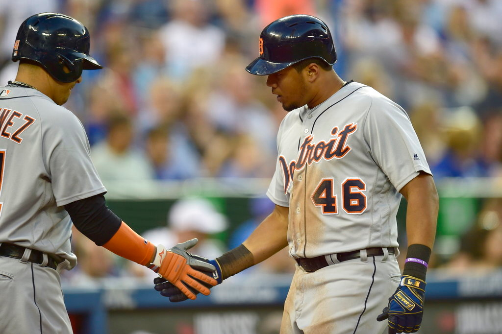 . Detroit Tigers\' Jeimer Candelario (46) celebrates with Victor Martinez after his home run against the Toronto Blue Jays during the seventh inning of a baseball game Friday, June 29, 2018, in Toronto. (Frank Gunn/The Canadian Press via AP)