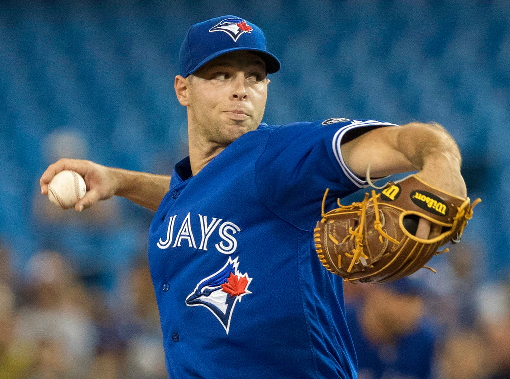 . Toronto Blue Jays starter Sam Gaviglio pitches during the first inning of a baseball game against the Detroit Tigers in Toronto, Saturday, June 30, 2018. (Fred Thornhill/The Canadian Press via AP)