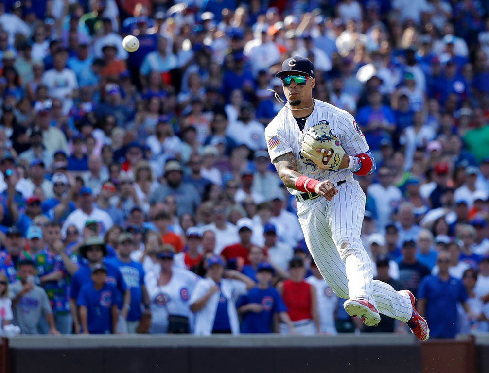 . Chicago Cubs\' Javier Baez throws out Detroit Tigers\' Jose Iglesias to end a baseball game Tuesday, July 3, 2018, in Chicago. The Cubs won 5-3. (AP Photo/Charles Rex Arbogast)
