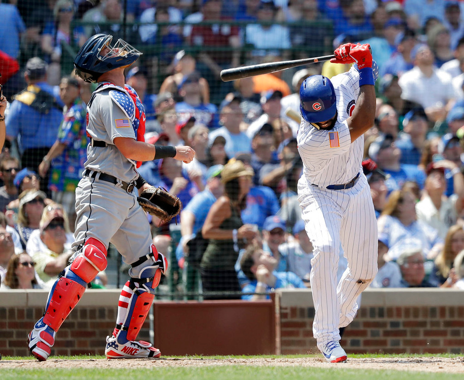 . Chicago Cubs\' Jason Heyward slams his bat to the ground, breaking it, as Detroit Tigers catcher James McCann watches his pop up with the bases during the third inning of a baseball game Tuesday, July 3, 2018, in Chicago. (AP Photo/Charles Rex Arbogast)