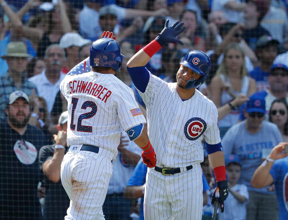 . Chicago Cubs\' Kyle Schwarber (12) celebrates his home run with Willson Contreras during the eighth inning of a baseball game against the Detroit Tigers Tuesday, July 3, 2018, in Chicago. (AP Photo/Charles Rex Arbogast)