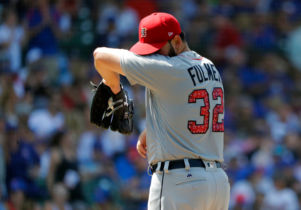 . Detroit Tigers starting pitcher Michael Fulmer wipes the sweat from his face during the fifth inning of a baseball game against the Chicago Cubs, Tuesday, July 3, 2018, in Chicago. (AP Photo/Charles Rex Arbogast)