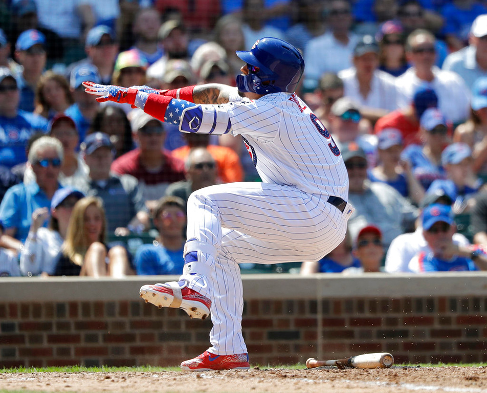. Chicago Cubs\' Javier Baez reacts after fouling a pitch from Detroit Tigers starting pitcher Michael Fulmer off his left leg during the fifth inning of a baseball game Tuesday, July 3, 2018, in Chicago. (AP Photo/Charles Rex Arbogast)