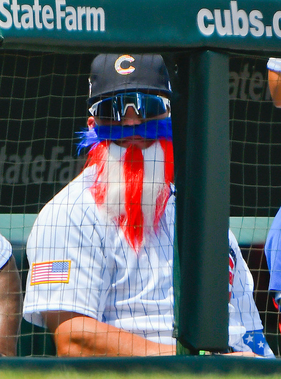 . Chicago Cubs left fielder Kyle Schwarber (12) wears Uncle Sam garb during the first inning of a baseball game against the Detroit Tigers on Wednesday, July 4, 2018, in Chicago. (AP Photo/Matt Marton)
