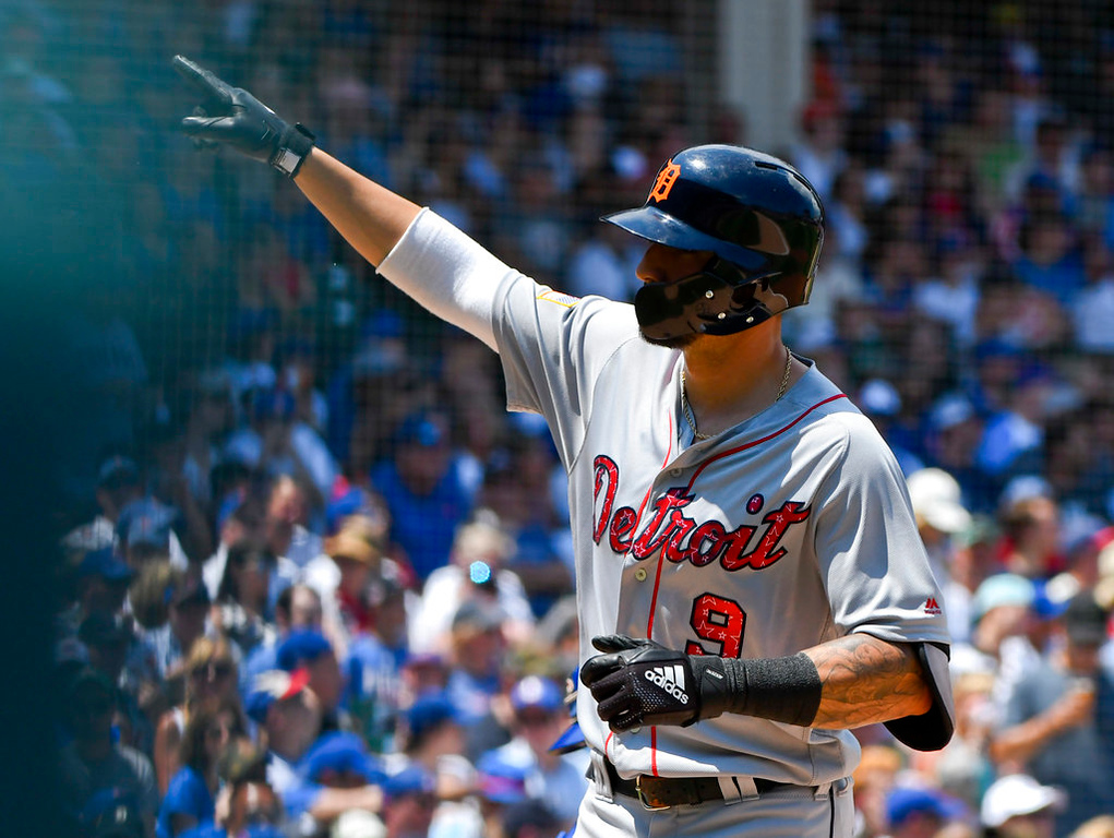 . Detroit Tigers\' Nicholas Castellanos (9) gestures after hitting a home run during the first inning of a baseball game against the Chicago Cubs on Wednesday, July 4, 2018, in Chicago. (AP Photo/Matt Marton)