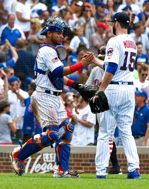 . Chicago Cubs\' Willson Contreras (40) shakes hands with relief pitcher Brandon Morrow (15) at the end of a baseball game against the Detroit Tigers on Wednesday, July 4, 2018, in Chicago. The Chicago Cubs won 5-2. (AP Photo/Matt Marton)