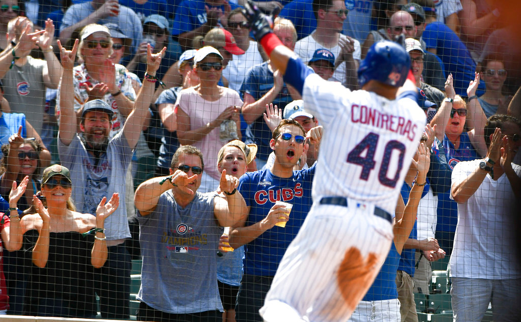 . Chicago Cubs\' Willson Contreras (40) points to fans after his home run during the sixth inning of a baseball game against the Detroit Tigers on Wednesday, July 4, 2018, in Chicago. (AP Photo/Matt Marton)