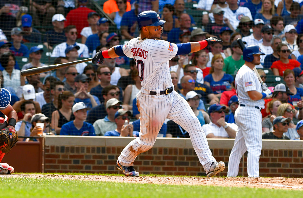 . Chicago Cubs\' Willson Contreras (40) hits a two RBI double during the seventh inning of a baseball game against the Detroit Tigers on Wednesday, July 4, 2018, in Chicago. (AP Photo/Matt Marton)