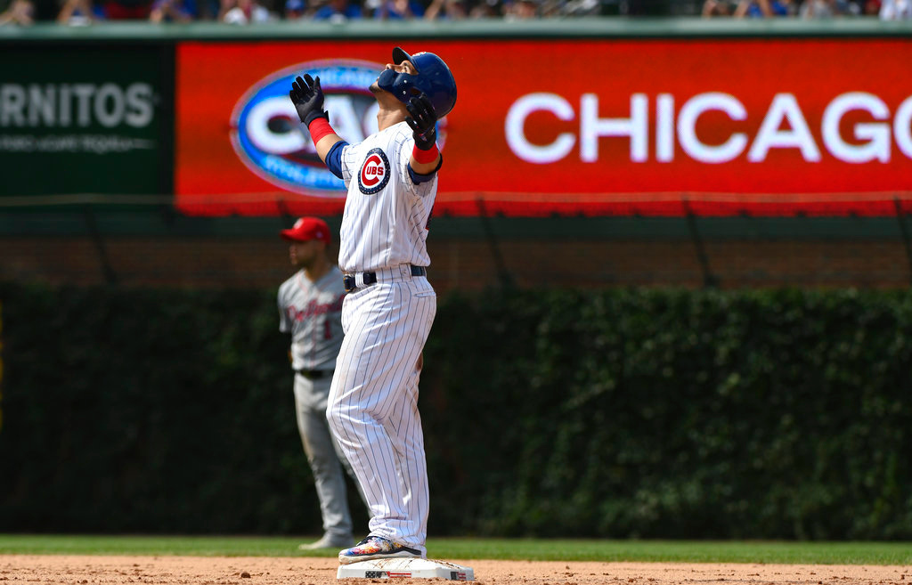 . Chicago Cubs\' Willson Contreras (40) after he hit a two RBI double during the seventh inning of a baseball game against the Detroit Tigers on Wednesday, July 4, 2018, in Chicago. (AP Photo/Matt Marton)