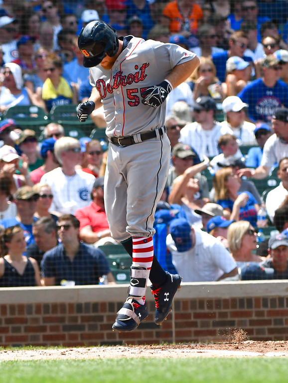 . Detroit Tigers\' John Hicks jumps at home plate as he celebrates his home run during the third inning of a baseball game against the Chicago Cubs on Wednesday, July 4, 2018, in Chicago. (AP Photo/Matt Marton)