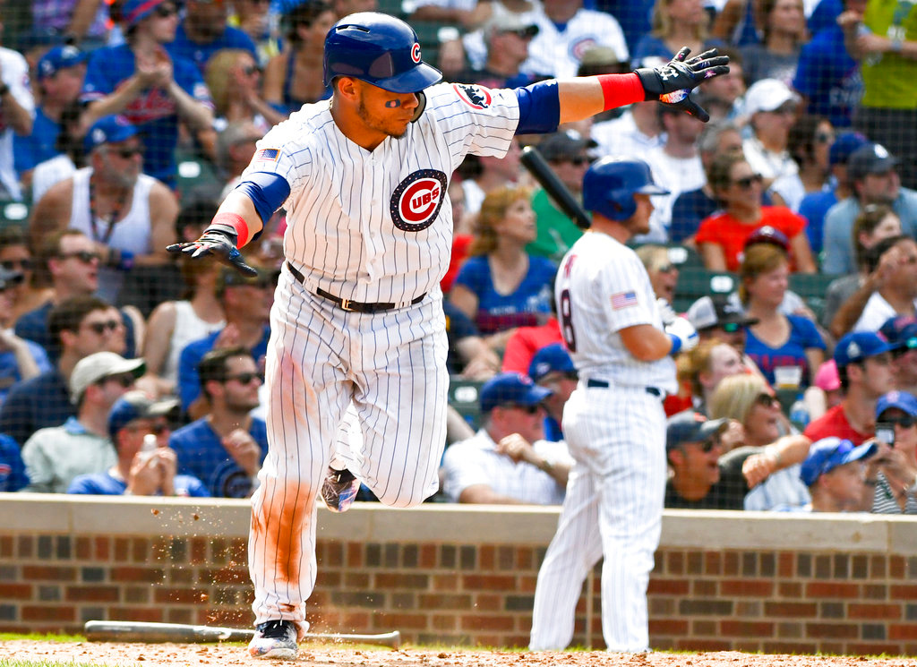 . Chicago Cubs\' Willson Contreras (40) after he hits a two RBI double during the seventh inning of a baseball game against the Detroit Tigers on Wednesday, July 4, 2018, in Chicago. (AP Photo/Matt Marton)