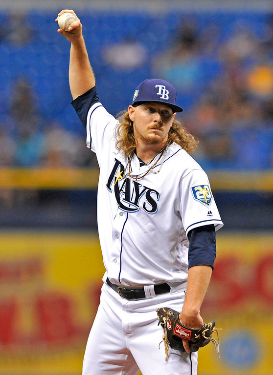 . Tampa Bay Rays starter Ryne Stanek stretches between pitches during the first inning of a baseball game against the Detroit Tigers Tuesday, July 10, 2018, in St. Petersburg, Fla. (AP Photo/Steve Nesius)