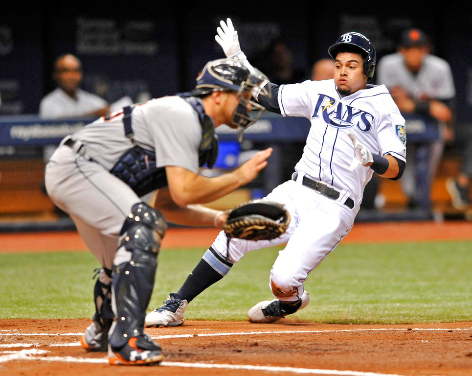 . Tampa Bay Rays\' Willy Adames, right, beats the throw to Detroit Tigers catcher John Hicks to score on Kevin Kiermaier\'s RBI-single during the third inning of a baseball game Tuesday, July 10, 2018, in St. Petersburg, Fla. (AP Photo/Steve Nesius)