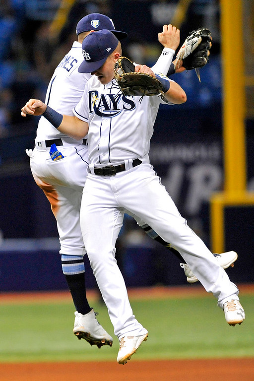 . Tampa Bay Rays\' Willy Adames, left, and Jake Bauers celebrate a 5-2 win over the Detroit Tigers at the end of a baseball game Tuesday, July 10, 2018, in St. Petersburg, Fla. (AP Photo/Steve Nesius)